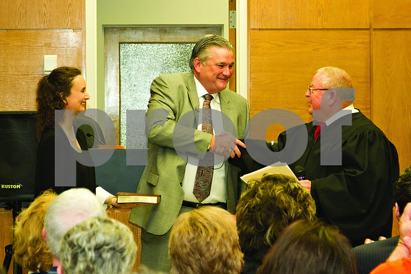 Photo by Shannon Wilson / Tyler Morning Telegraph Judge Jack Skeen Jr. and Sheriff Larry R. Smith shake hands after Sheriff Smith is sworn in as Smith County Sheriff at the Oath of Office Ceremony at the Smith County Courthouse on Tuesday morning.