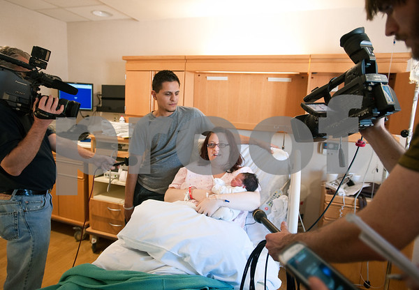 photo by Sarah A. Miller/Tyler Morning Telegraph  Media crews surround Ruben and Chantel Galaz of Lindale and their newborn Gavin Reed Galaz Wednesday January 1, 2014 at East Texas Medical Center in Tyler. The baby was the first baby of the new year and was born at 6:33 a.m.