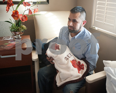 photo by Sarah A. Miller/Tyler Morning Telegraph  Alejandro Hernandez of Mineola holds his son Alex Hernandez, who was the first baby of the new year born at Mother Frances Hospital. He weighed 8 pounds, 4 ounces.