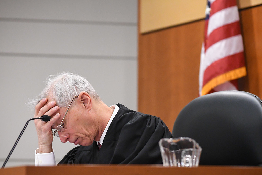 . Lorain County Common Pleas Court Judge James Miraldi hangs his head in his hand and chokes back tears before granting judicial release to Adrianna M. Young, Jan. 4, 2018. Miraldi remarked Jan. 4 was his hardest day on the bench since being seated in 2007. The 26-year-old Oberlin woman, who appeared via closed-circuit television, was granted early release after serving nearly eight months of a 54-month prison term, for causing the July 28, 2015 death of 34-year-old Debra Majkut, of Amherst Township. (Eric Bonzar�The Morning Journal)