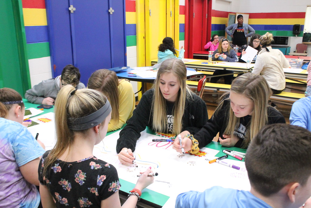 . Kristi Garabrandt � The News-Herald <br> Eighth-graders from Ridge Middle School work  to create posters for the April 7, Deepwood Idol Competition during Ridge Middle School\'s Day of Service on March 27, 2018.