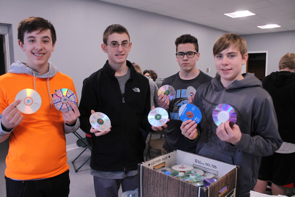 . Kristi Garabrandt � The News-Herald <br> Matthew Wasko, 14, Austin Kiggins, 13, Jakob Morris, 14 and Eric Toth, 14 show off the  spinning tops they made our of recycled materials for the Earth Day festival during the Ridge Middle School Day of Service on March 27, 2018.