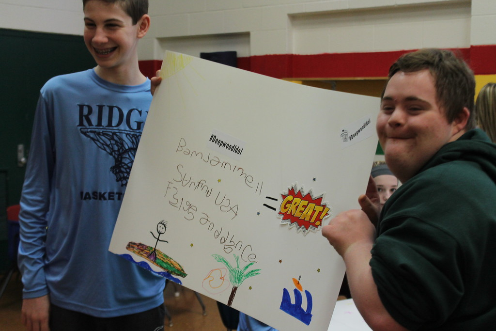 . Kristi Garabrandt � The News-Herald <br> Sam Lynch, an eighth grade student from Ridge Middle School and John Hewitt, a student at Broadmoor worked  together during Ridge Middle School\'s Day of Service on March 27,  to create posters for the April 7, Deepwood Idol Competition.