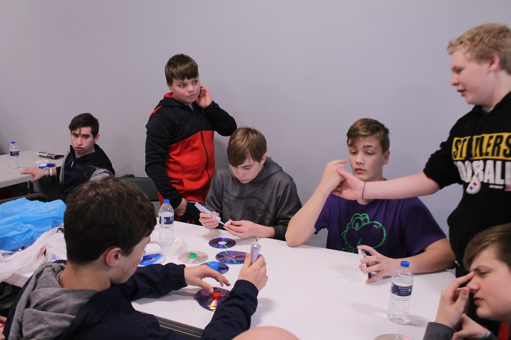 . Kristi Garabrandt � The News-Herald <br> Eighth-grade students assemble spinning tops out of recycled materials for the Earth Day festival during the Ridge Middle School Day of Service on March 27, 2018.