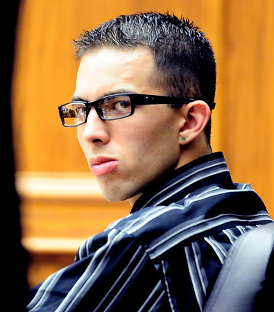 Zachrey Harris, 21, watches his lawyer Nick Avila during his trial at the Boulder County Justice Center in Boulder, Colorado April 5, 2011.  Harris was arrested on suspicion of harassment and bias-motivated crime in connection with the Sept. 18 attack that left University of Colorado student Olubiyi Ogundipe with serious injuries.  CAMERA/Mark Leffingwell