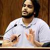 Ahmad Abdulkareem show how he pushed Joseph Coy back on the night of their confrontation during Joseph Coy's trial at the Boulder County Justice Center in Boulder, Colorado April 20, 2011.  Coy was arrested on suspicion of harassment and bias-motivated crime in connection with the Sept. 18 attack that left University of Colorado student Olubiyi Ogundipe with serious injuries.  CAMERA/Mark Leffingwell