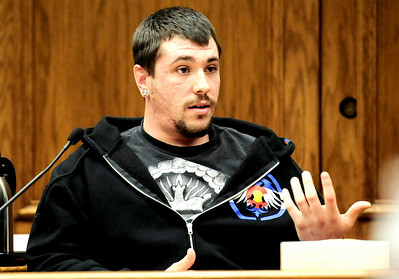 Justin Carlson, friend of Joseph Coy and with Coy on Sept. 18th, 2010,  answers questions while on the witness stand during Joseph Coy's trial at the Boulder County Justice Center in Boulder, Colorado April 20, 2011.  Coy was arrested on suspicion of harassment and bias-motivated crime in connection with the Sept. 18 attack that left University of Colorado student Olubiyi Ogundipe with serious injuries.  CAMERA/Mark Leffingwell
