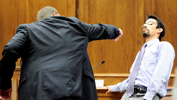 Prosecutor Ken Kupfner (left) makes a slow swing with his are to mimic  a punch while witness Cesar Cantu Jr. (right) demonstrates how Olubiyi Ogundipe was falling when saw the assult during Joseph Coy's trial at the Boulder County Justice Center in Boulder, Colorado April 20, 2011.  Coy was arrested on suspicion of harassment and bias-motivated crime in connection with the Sept. 18 attack that left University of Colorado student Olubiyi Ogundipe with serious injuries.  CAMERA/Mark Leffingwell