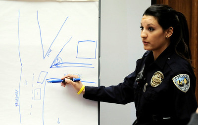 Officer Jaime Mayoral, CUPD, points out on a map she created where she was when she saw the incident from last September during Joseph Coy's trial at the Boulder County Justice Center in Boulder, Colorado April 20, 2011.  Coy was arrested on suspicion of harassment and bias-motivated crime in connection with the Sept. 18 attack that left University of Colorado student Olubiyi Ogundipe with serious injuries.  CAMERA/Mark Leffingwell
