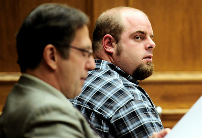 Joseph Coy watches prosecutor Karen Peters question Ahmad Abdulkareem during Coy's trial at the Boulder County Justice Center in Boulder, Colorado April 20, 2011.  Coy was arrested on suspicion of harassment and bias-motivated crime in connection with the Sept. 18 attack that left University of Colorado student Olubiyi Ogundipe with serious injuries.  CAMERA/Mark Leffingwell