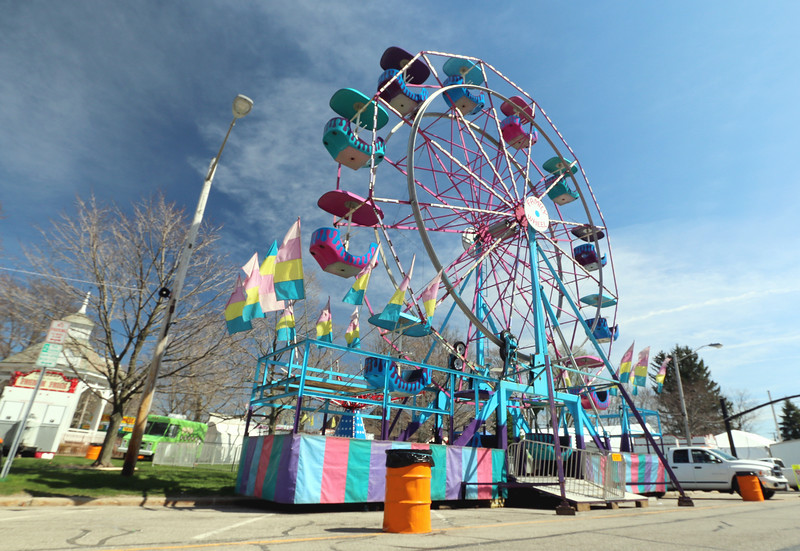 Jonathan Tressler - The News-Herald. The Geauga County Maple Festival's Ferris wheel stands at the ready April 20 as workers scurry around the square, tending to the final details before the event kicks off April 21. It runs though April 24.