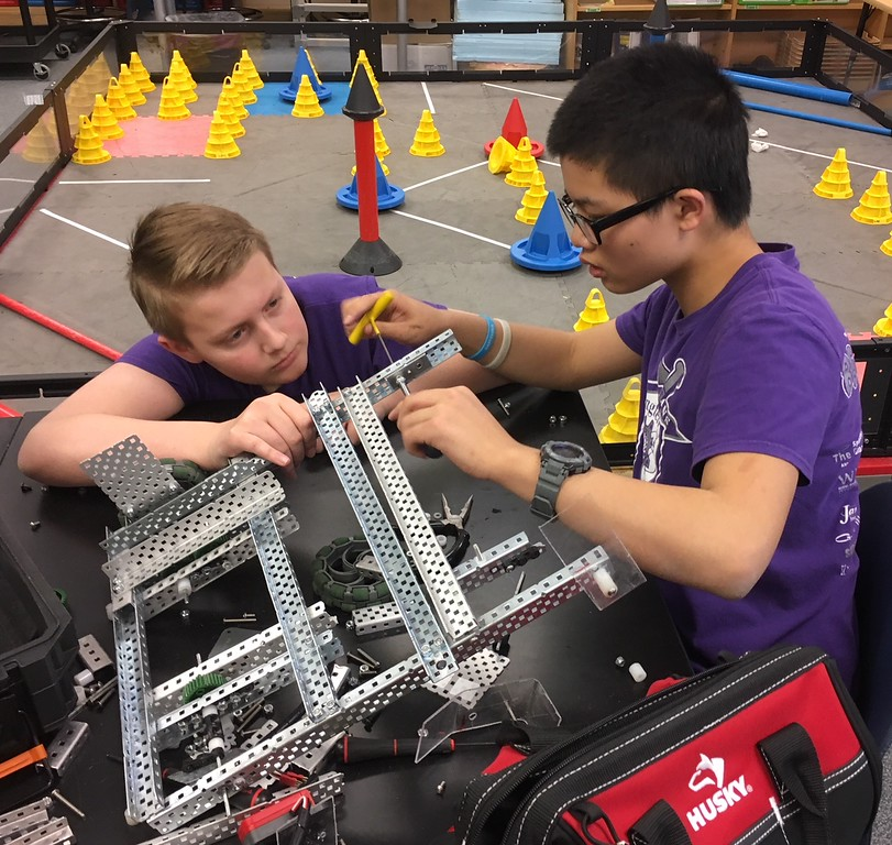 . Richard Payerchin - The Morning Journal <br> Longellow Middle School robotics team members Shane Ramey-Rowland, left, and Andy Zhang work on the robot Titanious on April 11, 2018. Lorain City Schools\' Longfellow Middle School Team Titanious Robotics will head to the VEX Robotics World Championship, scheduled April 25 to 28 in Louisville.