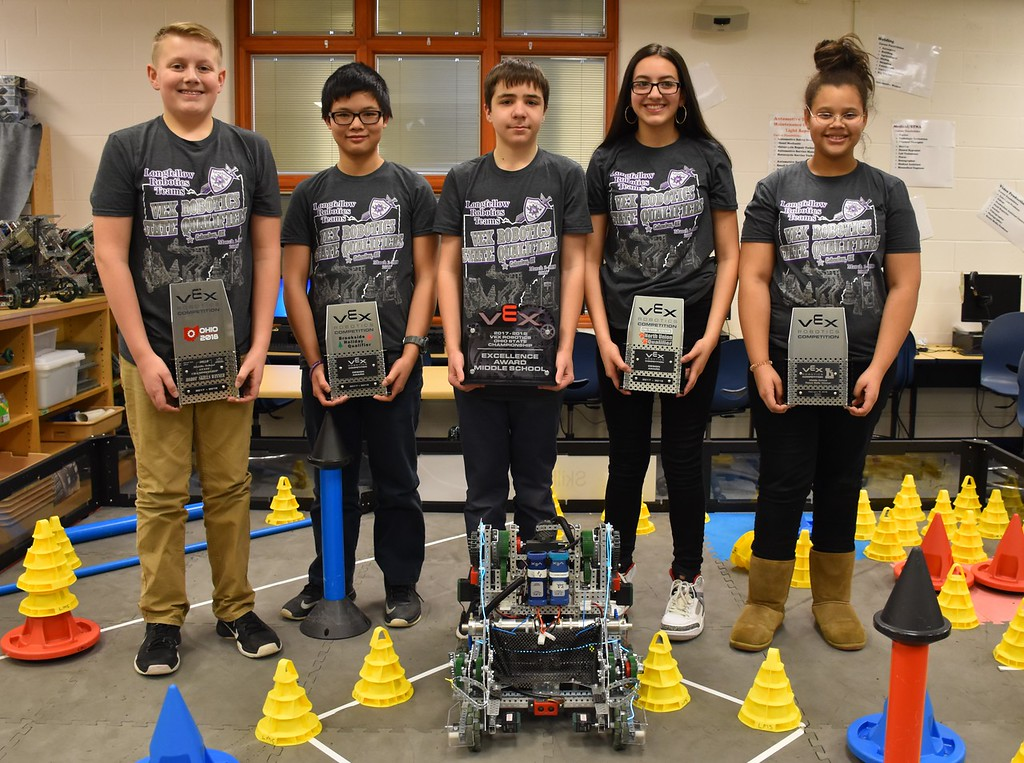 . Submitted photo - Longfellow Middle School <br> Lorain City Schools\' Longfellow Middle School Team Titanious Robotics will head to the VEX Robotics World Championship, scheduled April 25 to 28 in Louisville. From left are squad 8609B: Shane Ramey-Rowland, Andy Zhang, Aidan Kodman, Karen Gallegos and Jada McCall. The robot Titanious is sitting in front of the students.