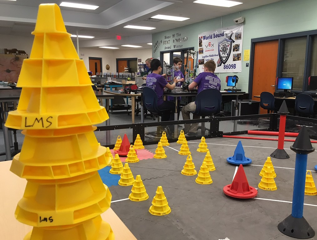""". Richard Payerchin - The Morning Journal <br> Yellow, red and blue cones are used in the game \""""In the Zone\"""" in the practice field at the Longellow Middle School robotics team classroom on April 11, 2018. Lorain City Schools\' Longfellow Middle School Team Titanious Robotics will head to the VEX Robotics World Championship, scheduled April 25 to 28 in Louisville."""