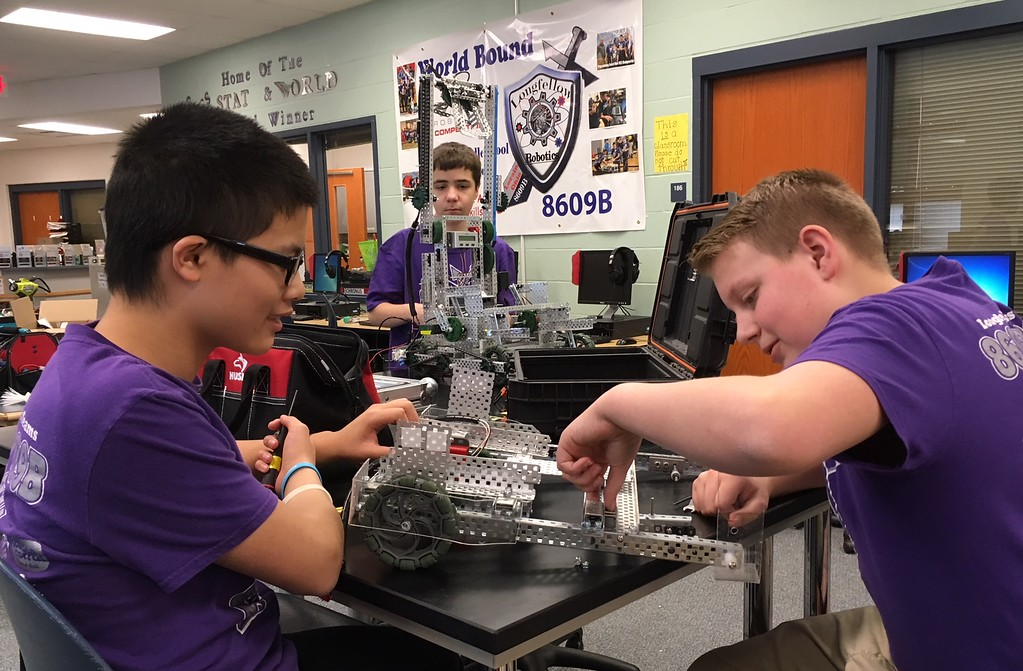 . Richard Payerchin - The Morning Journal <br> Longfellow Middle School robotics team members Andy Zhang, left, Aidan Kodman, center, and Shane Ramey-Rowland work on the robot Titanious on April 11, 2018. Lorain City Schools\' Longfellow Middle School Team Titanious Robotics will head to the VEX Robotics World Championship, scheduled April 25 to 28 in Louisville.
