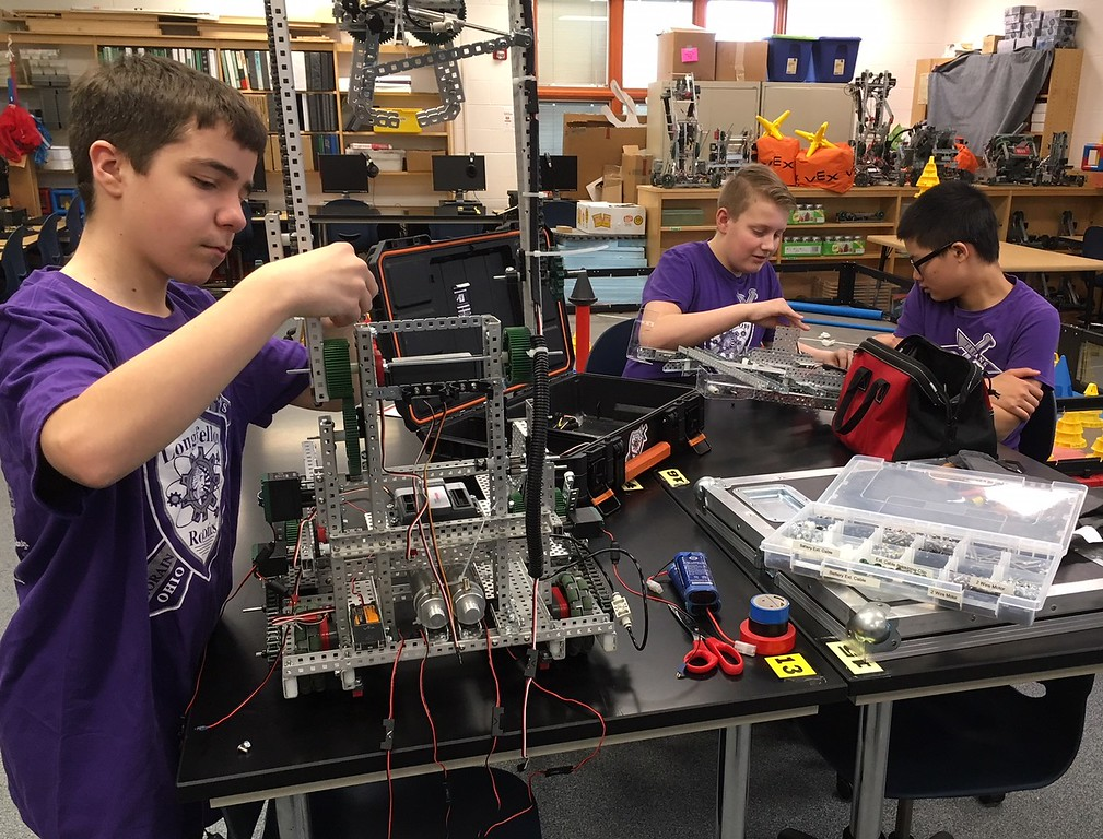 . Richard Payerchin - The Morning Journal <br> Longfellow Middle School robotics team members Aidan Kodman, left, Shane Ramey-Rowland, center, and Andy Zhang work on the robot Titanious on April 11, 2018. Lorain City Schools\' Longfellow Middle School Team Titanious Robotics will head to the VEX Robotics World Championship, scheduled April 25 to 28 in Louisville.