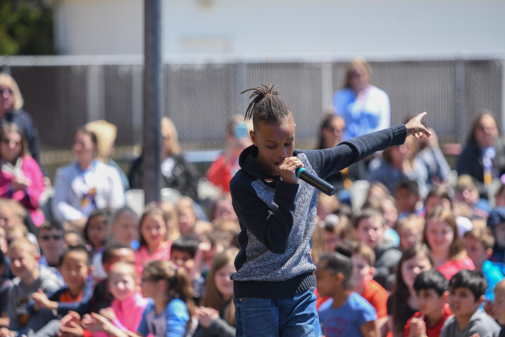 ". Eric Bonzar�The Morning Journal. Ten-year-old Ebiyon Tonwe performs an original rap titled ""You\'re A Star\"" during Avon Heritage Elementary School\'s special assembly to close out Autism Awareness Month, April 30, 2018."