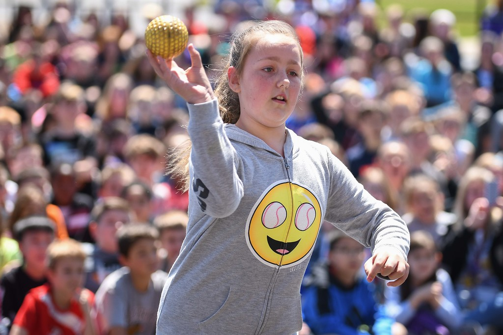 . Eric Bonzar�The Morning Journal. Ten-year-old fifth-grader Jada Smith tosses a ball and tries to dunk Mayor Bryan Jensen in a dunk tank, during Avon Heritage Elementary School\'s special assembly to close out Autism Awareness Month, April 30, 2018.