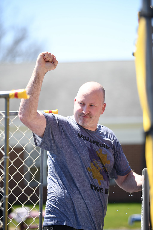 . Eric Bonzar�The Morning Journal. Assistant Superintendent Ben Hodge pumps his fist after being dunked in a dunk tank by 9-year-old fourth-grader Mia Khandekar, during Avon Heritage Elementary School\'s special assembly to close out Autism Awareness Month, April 30, 2018.
