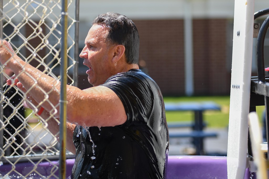 . Eric Bonzar�The Morning Journal. Avon Mayor Bryan Jensen reacts after being dunked in a dunk tank by 10-year-old fifth-grader Jada Smith, during Avon Heritage Elementary School\'s special assembly to close out Autism Awareness Month, April 30, 2018.
