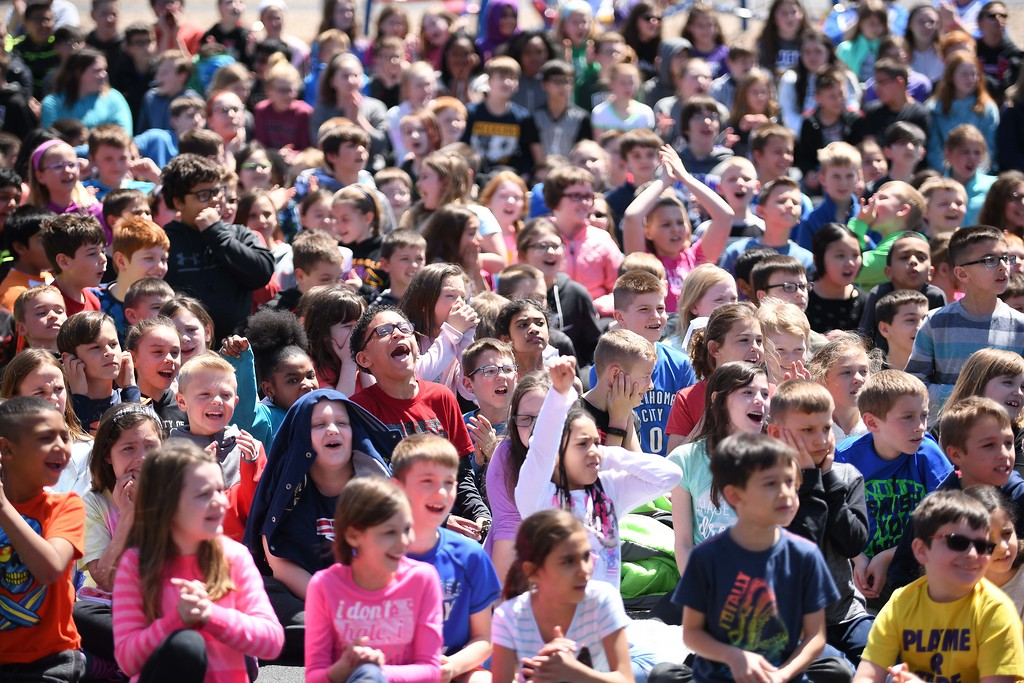 . Eric Bonzar�The Morning Journal. Students at Avon Heritage Elementary School cheer as Mayor Bryan Jensen is announced as a surprise guest, during the school\'s special assembly to close out Autism Awareness Month, April 30, 2018.