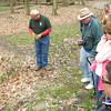 Richard Payerchin - The Morning Journal <br> Hikers gather around as Grant Thompson, chief naturalist for Lorain County Metro Parks, points out Japanese knotweed on Mary 1, 2016, at Elywood Park in Elyria. About 50 people participating in the annual Spring Walk, a collaborative program of Lorain County Metro Parks, Friends of Cascade Park and the Lorain County Historical Society.