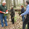 Richard Payerchin - The Morning Journal <br> From left, Grant Thompson, chief naturalist for Lorain County Metro Parks, consults a field guide with hikers Matt Nahorn of Amherst, Barb Galvin of Eaton Township and Gary Pressnell of Elyria on May 1, 2016. They were among about 50 people participating in the annual Spring Walk, a collaborative program of Lorain County Metro Parks, Friends of Cascade Park and the Lorain County Historical Society. Thompson, Nahorn and Galvin also were holding garlic mustard, an invasive plant they pulled up in the park.