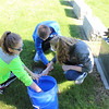 All Saints of St. John Vianney School students cleaned veterans headstones at Mentor Cemetery on May 9. (Tawana Roberts, The News-Herald)
