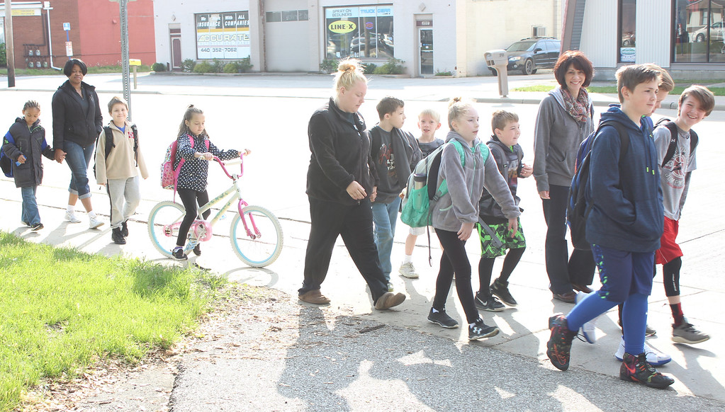 . Hadden Elementary School students trek to school together on Walk & Bike to School Day, May 10. (Tawana Roberts, The News-Herald)