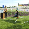 Richard Payerchin - The Morning Journal <br> Ken Christensen, senior biologist for Davey Tree, speaks at the Vermilion Valley Service Plaza of the Ohio Turnpike on May 20, 2016, as turnpike Executive Director Randy Cole looks on with his son, Porter, 2. Lorain County JVS students planted a Native Pollinator Plant Garden, the first of its kind along the Ohio Turnpike, at the Vermilion Valley service plaza, with 17 species of perennials native to Ohio and that will attract birds, butterflies and other wildlife.