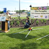 Richard Payerchin - The Morning Journal <br> Mike Mennett, executive director of Keep Ohio Beautiful, speaks at the Vermilion Valley Service Plaza of the Ohio Turnpike on May 20, 2016, as turnpike Executive Director Randy Cole looks on with his son, Porter, 2. Lorain County JVS students planted a Native Pollinator Plant Garden, the first of its kind along the Ohio Turnpike, at the Vermilion Valley service plaza, with 17 species of perennials native to Ohio and that will attract birds, butterflies and other wildlife.