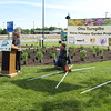 Richard Payerchin - The Morning Journal <br> Lorain County Commissioner Lori Kokoski speaks at the Vermilion Valley Service Plaza of the Ohio Turnpike on May 20, 2016, as turnpike Executive Director Randy Cole looks on with his son, Porter, 2. Lorain County JVS students planted a Native Pollinator Plant Garden, the first of its kind along the Ohio Turnpike, at the Vermilion Valley service plaza, with 17 species of perennials native to Ohio and that will attract birds, butterflies and other wildlife.