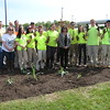 Richard Payerchin - The Morning Journal <br> Lorain County JVS students show off their dirty hands as they pose for a group portrait with Lorain County officials and staff of the Ohio Turnpike and Infrastructure Commission on May 20, 2016. The students were out to plant a Native Pollinator Plant Gardent, the first of its kind along the highway, at the Vermilion Valley service plaza.