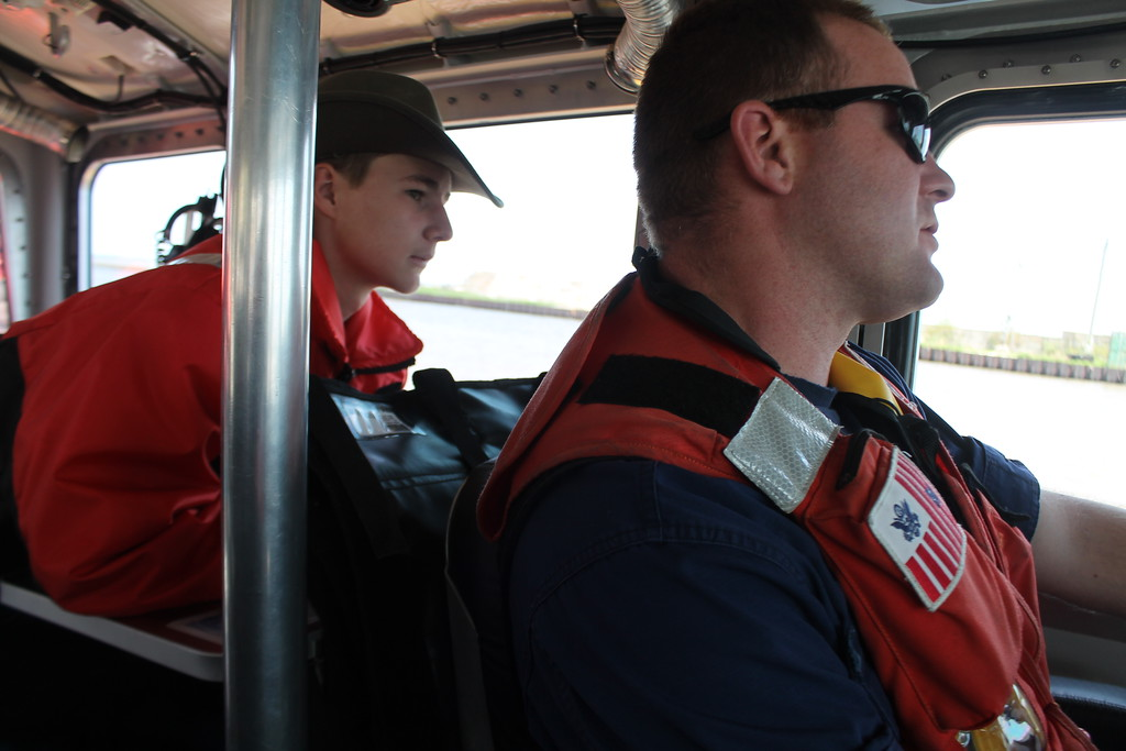 . Cole Dockus, 15, Lakewood,  talks with Coast Guard member Coxswain  Harry Ramsey about the qualifications needed to join the Coast Guard and drive a  rescue boat. Kristi Garabrandt - The News-Herald