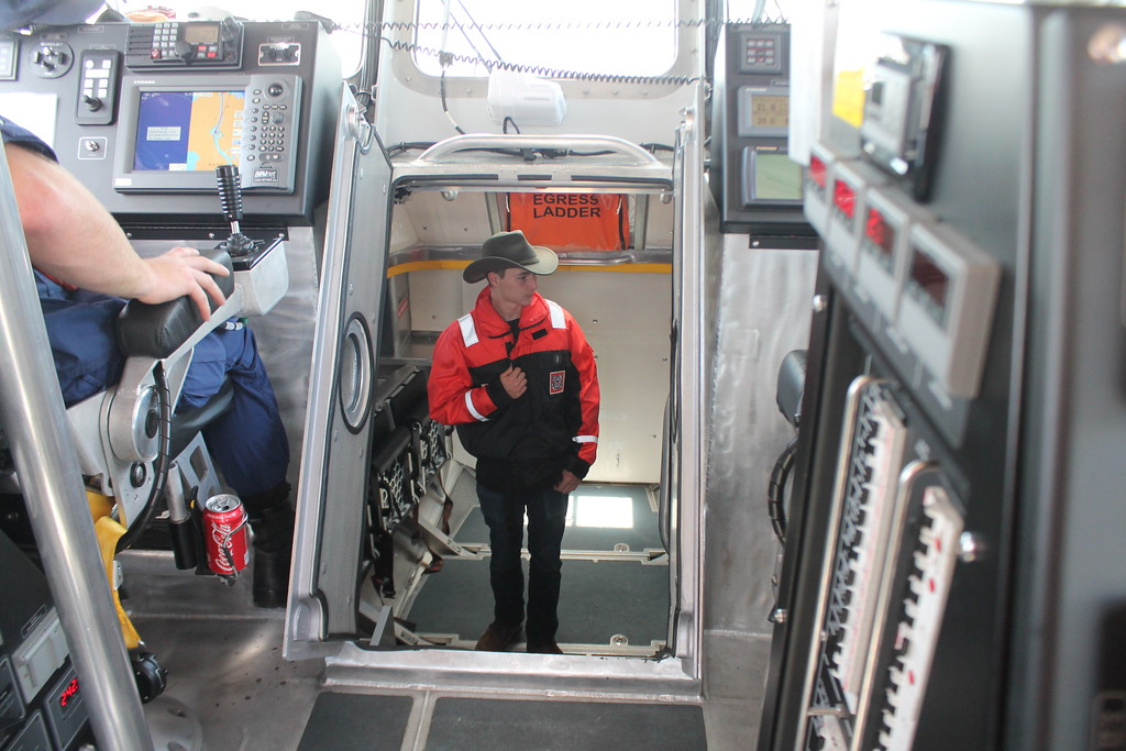 . Cole Dockus, 15, Lakewood, checks out the survivors bay on board the Coast Guard\'s 45\' response boat during the  USCG Fairport Station Open House on May 19. Kristi Garabrandt - The News-Herald