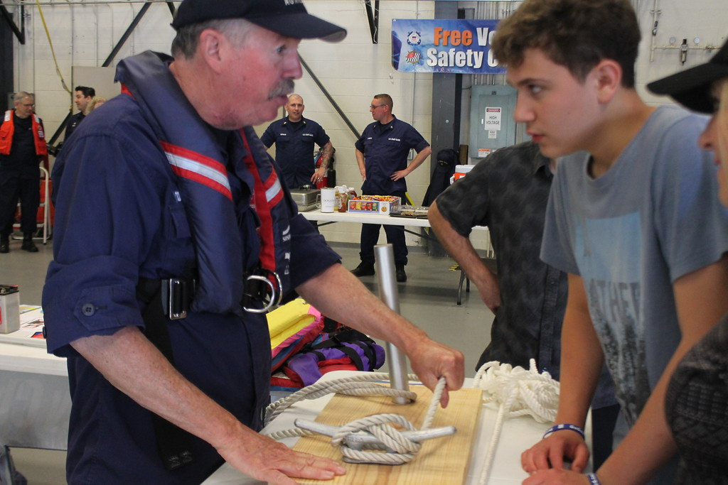. Coast Guard member Jim O\'Donnell shows Evan Stapleton, 15, Willoughby  how to properly tie commonly used boating knots during the USCG Fairport Station Open House,  May 19.  Kristi Garabrandt - The News-Herald