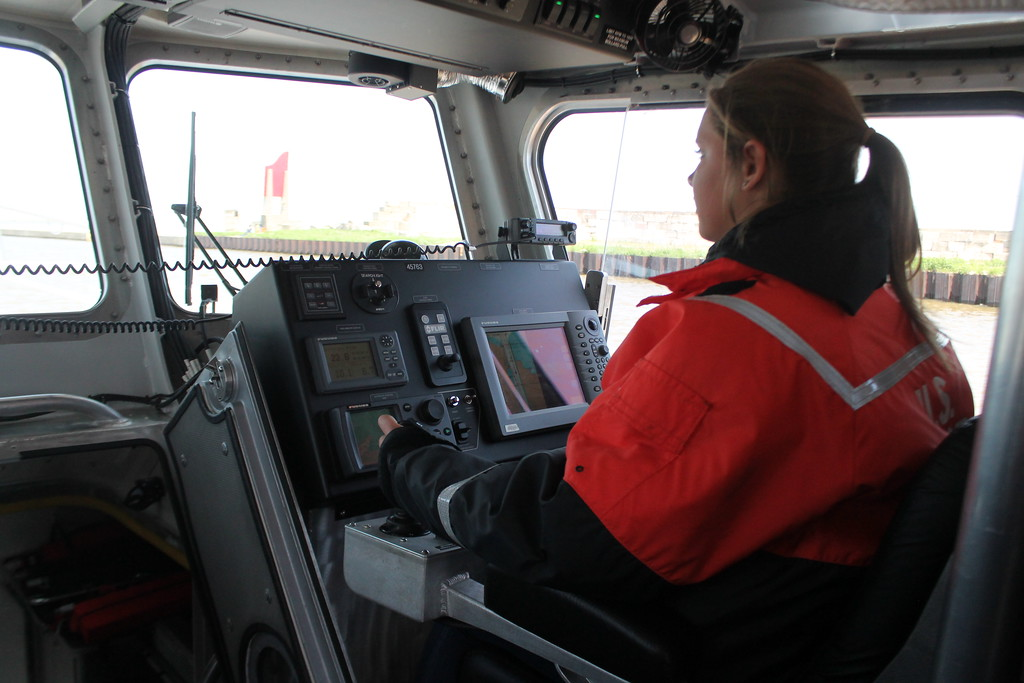 . Jessica Shansky, 15, Concord, assists with driving  the  Coast Guards 45\' foot response boat during the USCG Fairport Station Open House,  May 19.  Kristi Garabrandt - The News-Herald
