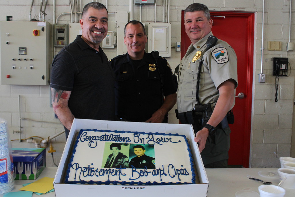. Kristi Garabrandt � The News-Herald <br> Eastlake Police Chief Larry Reik stands with Lieutenant Robert Gonzalez a 29 year veteran of Eastlake Police Department and Sergeant Chris Gutka a 22 year veteran of the department as Gonzalez and Gutka celebrate their retirements during a party held at the Eastlake Fire Department on May 25.