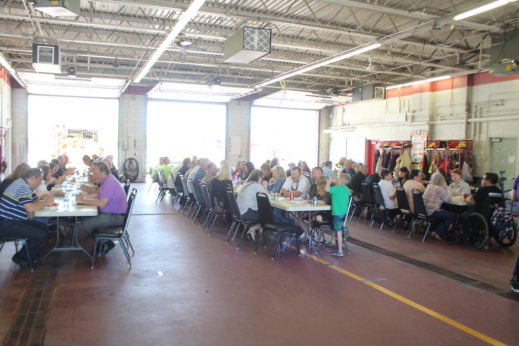 . Kristi Garabrandt � The News-Herald <br> It\'s estimated that over 100 friends, family members and co-workers turned up to celebrate the retirements of Lieutenant Robert Gonzalez a 29 year veteran of Eastlake Police Department and Sergeant Chris Gutka a 22 year veteran of the department  during a party held at the Eastlake Fire Department on May 25.
