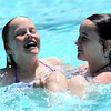 "Janelle Ross (left), 12, get dunked by Meghan Hempstead (right), 12, while playing at Scott Carpenter Park Pool in Boulder, Colorado May 27, 2011.  CAMERA/Mark Leffingwell <br /> <br /> Watch the video of people enjoying the Scott Carpenter Park Pool at  <a href=""http://www.dailycamera.com"">http://www.dailycamera.com</a>"
