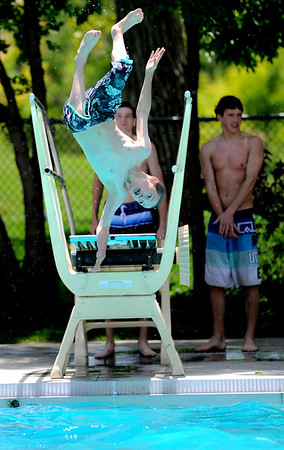 "Liam Blom Walker, 11, does a flip off the diving board at Scott Carpenter Park Pool in Boulder, Colorado May 27, 2011.  CAMERA/Mark Leffingwell <br /> <br /> Watch the video of people enjoying the Scott Carpenter Park Pool at  <a href=""http://www.dailycamera.com"">http://www.dailycamera.com</a>"