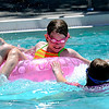 """Elaena Woldington (left), 10, tries to paddle away from Katy McCutchan (right), 10, while playing at Scott Carpenter Park Pool in Boulder, Colorado May 27, 2011.  CAMERA/Mark Leffingwell <br /> <br /> Watch the video of people enjoying the Scott Carpenter Park Pool at  <a href=""""http://www.dailycamera.com"""">http://www.dailycamera.com</a>"""