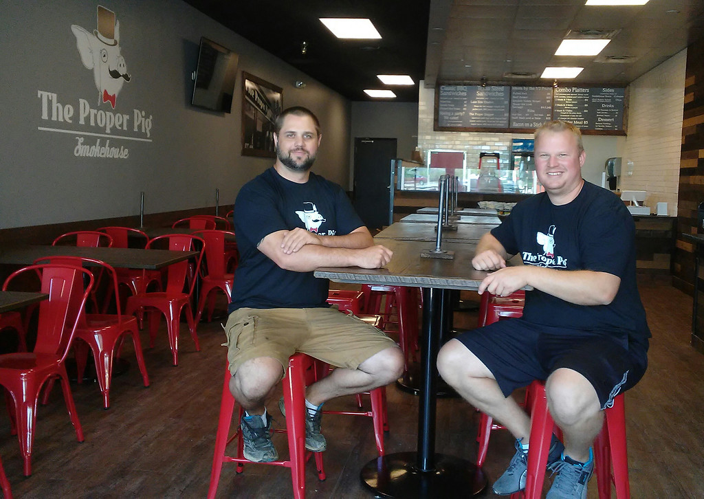 . Proper Pig is officially opening June 23 on Diamond Centre Drive in Mentor. The owners are Ted Dupaski, left, and Shane Vidovic. (Betsy Scott - The News-Herald)