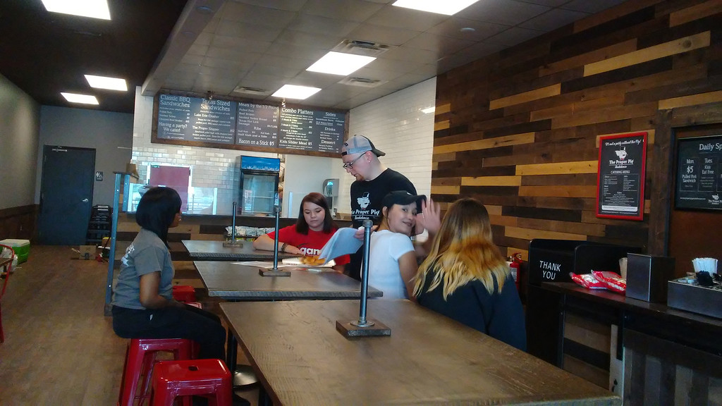 . General Manager Michael Scalise, center, trains staff at the Proper Pig, which is officially opening June 23 on Diamond Centre Drive in Mentor.  (Betsy Scott - The News-Herald)