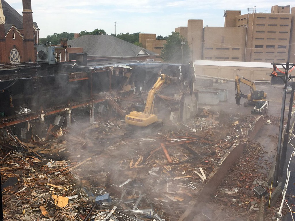 . Crews work to demolish the Dorthy Allen Building at 85 N. Park Place in Painesville on June 22. (Andrew Cass - The News-Herald)
