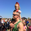 Carol Harper - The Morning Journal <br> Adrianna Calvey, 5, enjoys the best view to watch Hungarian dancers on stage at the Lorain International Festival on top of the shoulders of her father, Andrew Calvey, Avon, on June 25, 2016, at Black River Landing in Lorain. Adriana is wearing a costume worn by her mother, Amy Calvey, Avon, and grandmother, Ilona Berencsi, Lorain.