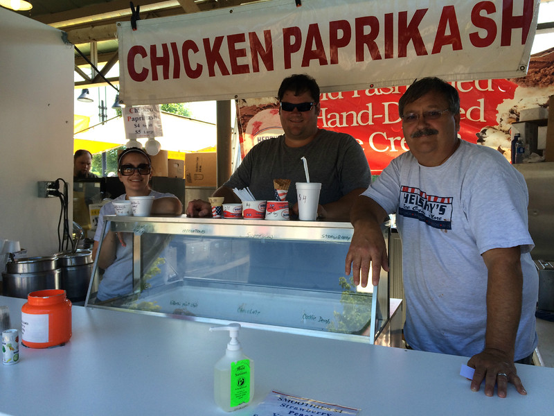 Carol Harper - The Morning Journal <br> Ray Spishak, right, Lagrange, offers Hungarian chicken paprikash and ice cream at a booth at Lorain International Festival June 25, 2016, at Black River Landing in Lorain. Spishak also operates Hershey's Ice Cream 'n More, 303 E. Main St., Lagrange.