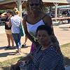 Carol Harper - The Morning Journal <br> Betty Jamison, 68, seated, Lorain, and her daughter, Marlene Smith, 48, Lorain, attended Lorain International Festival June 25, 2016, to enjoy different cultures, activities and food at Black River Landing in Lorain.