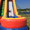 Carol Harper - The Morning Journal <br> Victor McCall, 4, Akron, tumbles down a bouncy slide during Lorain International Festival June 25, 2016, at Black River Landing in Lorain.