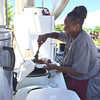 Carol Harper - The Morning Journal <br> Barbara Ballard scoops large portions of African American food into a container for guests at Lorain International Festival June 25, 2016, at Black River Landing in Lorain. For more than 20 years Ballard provided food for the festival.